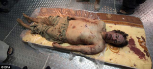 gaddafi dead body kept in cold storage